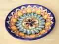 ウズベキスタンを代表する工芸品のリシタン陶器のプレート(小皿) オレンジ