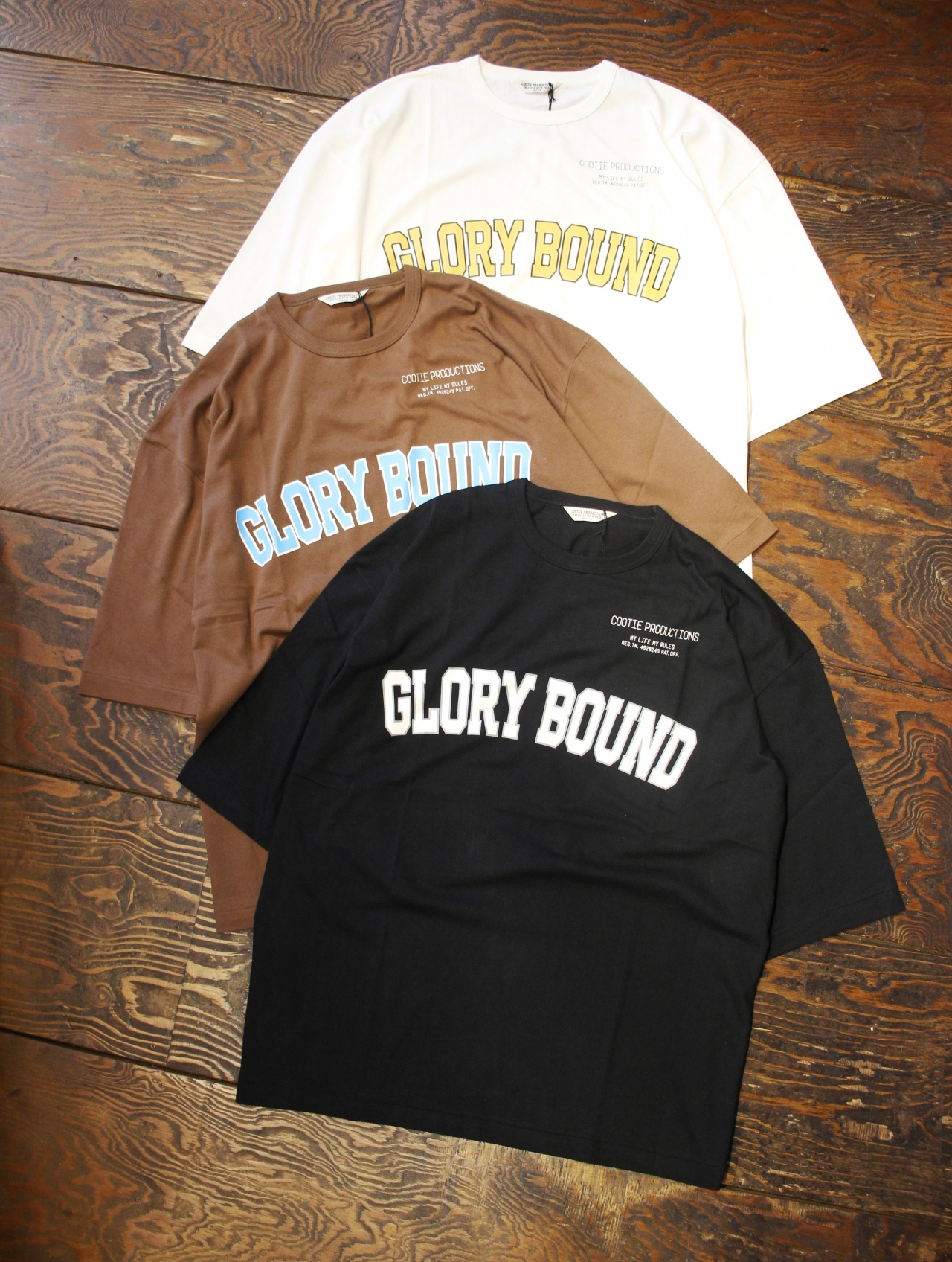 COOTIE  「Print S/S Tee (GLORY BOUND)」  プリントティーシャツ