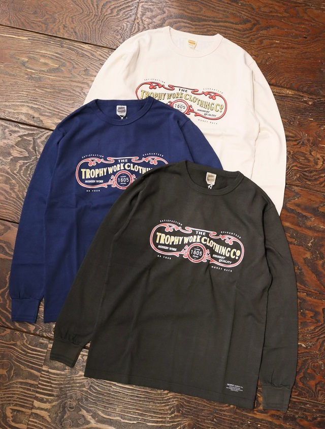 """TROPHY CLOTHING  「""""15th Work Logo""""OD L/S Tee」  プリントロンティー"""