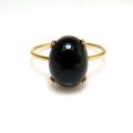 14kgfリング(指輪)天然石ブラックオニキス10×8mm(4本爪カボション・オーバル)(サイズ目安:7号)「ゴールドフィルド」(1個)