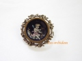 antique enamel putto brooch