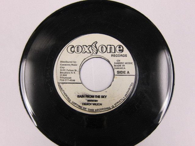 Aside DELROY WILSON / RAIN FROM THE SKY Bside HOW CAN I LOVE SOMEONE / COXSONE
