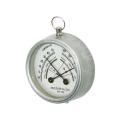 クールなスチール素材と、遊び心が散りばめられた文字盤がマッチした温湿度計。