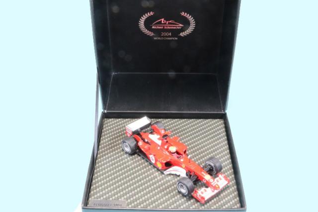 シューマッハショップ特注イクソ 1/43 フェラーリ F2004 日本GP 2004 Winner M.シューマッハ MS-F2004-04A