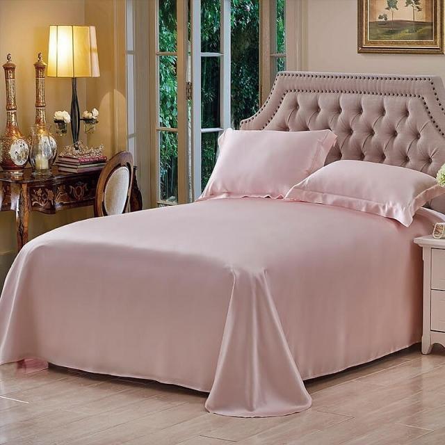 ピンク色のシルクフラットシーツ