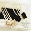 バックリボンモチーフ2連パールネックレス 【backribbon-p-necklace バックリボンモチーフ2連パールネックレス】 tocco closet (トッコクローゼット) collection