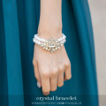 クリスタルフラワービジューつき2連パールブレスレット 【c_bracelet】 tocco closet(トッコクローゼット) Collection