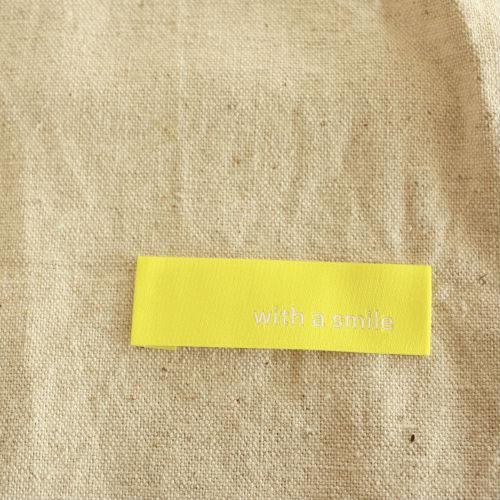 刺繍タグ-with a smile(黄色×白)